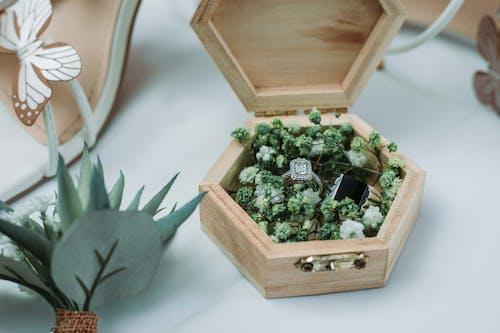 Stylish wedding rings in creative wooden box