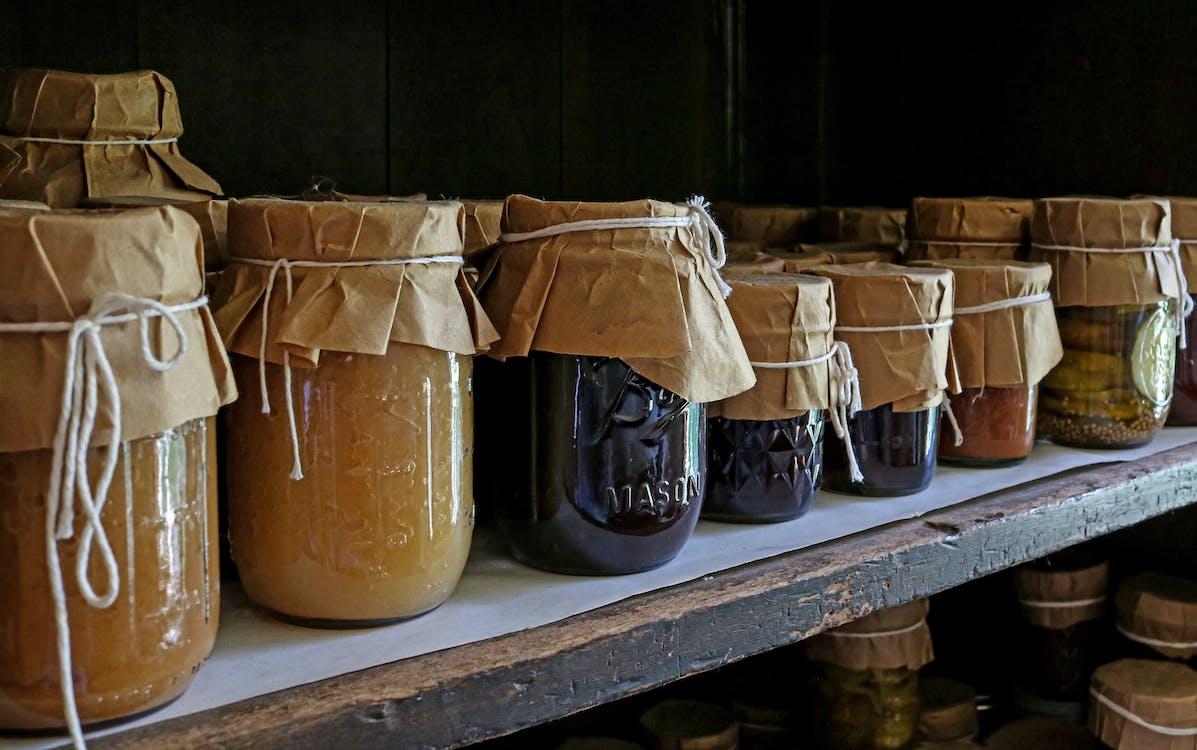 Brown Glass Jars on White Wooden Shelf