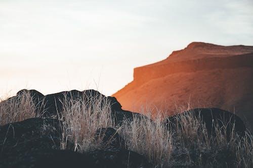 Cloudy sundown sky over rocky mountains