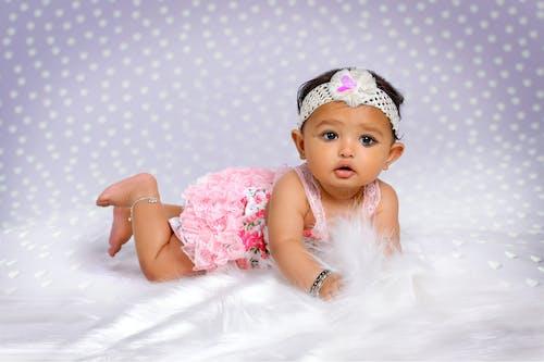 Cute ethnic baby in headband