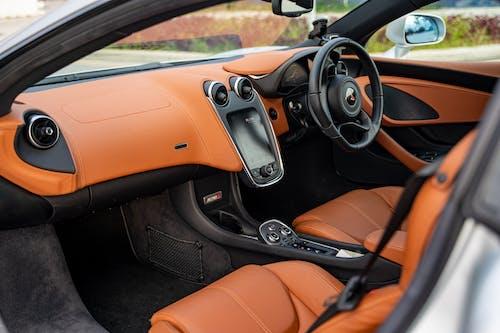 Black and Brown Car Steering Wheel