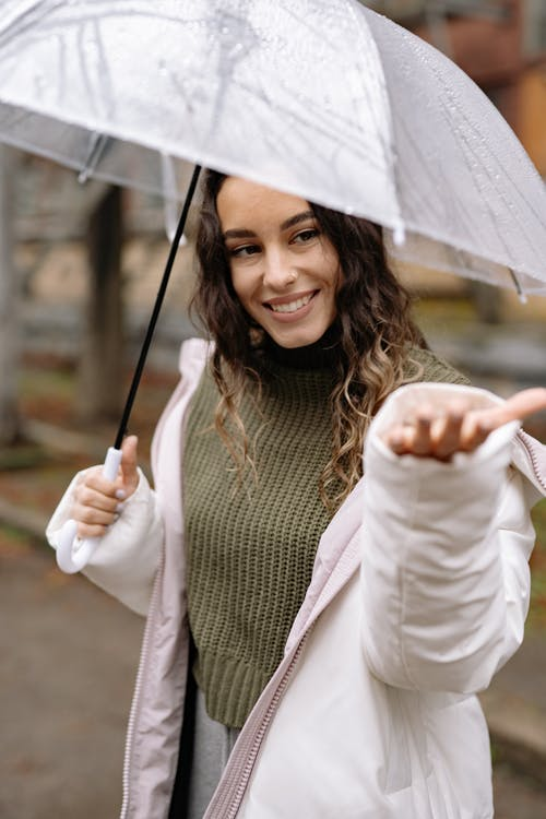 Woman in White Long Sleeve Shirt Holding Umbrella