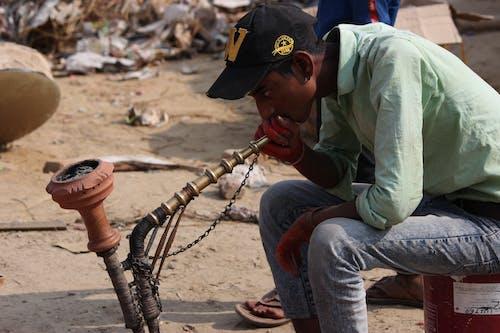 Free stock photo of boy, smoking, villager