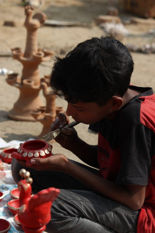 Free stock photo of child artist, clay pot, colouring