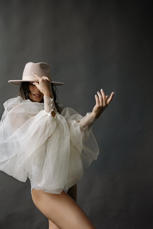 A Woman Wearing a Cowboy Hat Posing