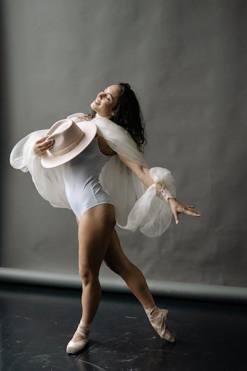 A Woman in a White Leotard Dancing