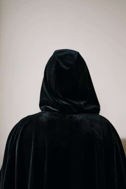 Person in Black Cloak