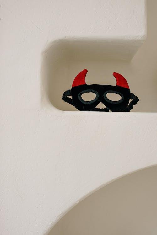 Devil Face Mask on the Shelf