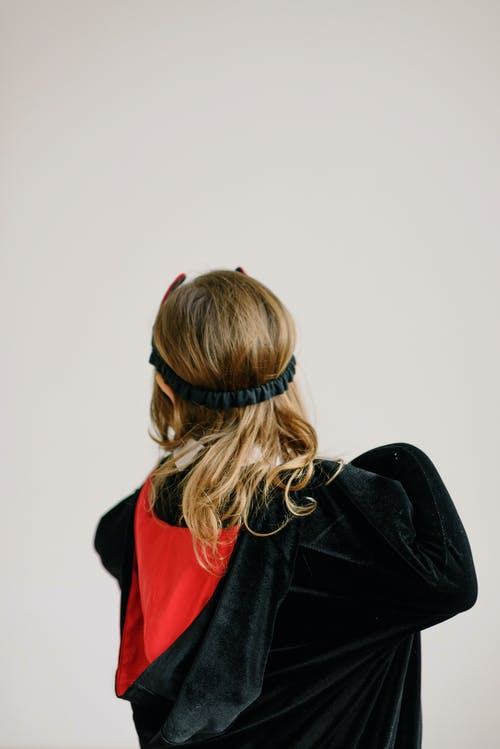 Girl in Black Cape with Red Hood