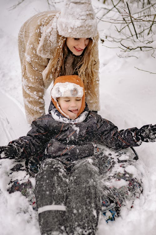 A Mother and Child Having Fun Playing in the Snow