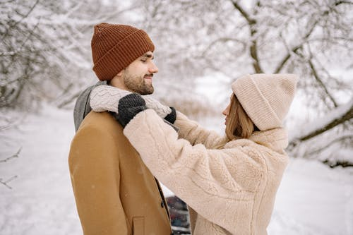 Shallow Focus Photo of a Lovely Couple in Winter Clothes Looking at Each Other