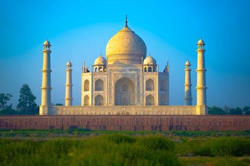 Amazing Taj Mahal Mausoleum under Blue Sky