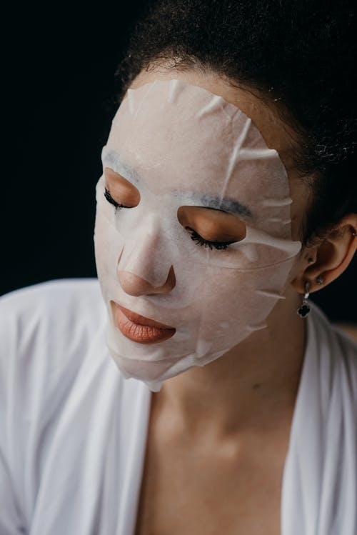 Close-Up Photo of a Woman with Facial Mask