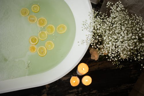 Bathtub with candles and flowers