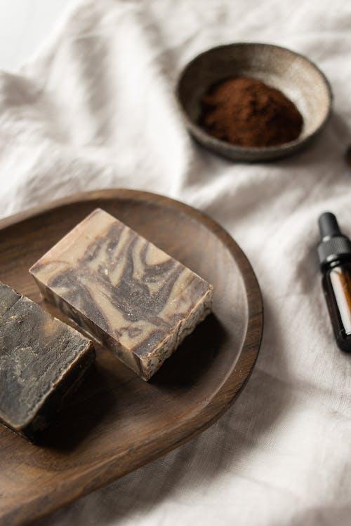 Handmade soap with patterns near coffee scrub