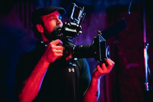Man in Black T-shirt Holding Black Video Camera