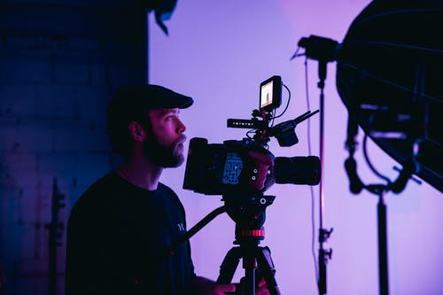 Man in Black Crew Neck Shirt Holding Black Dslr Camera