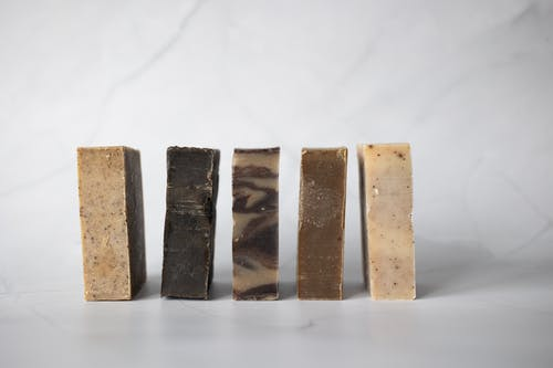 Set of handmade soaps placed on marble surface