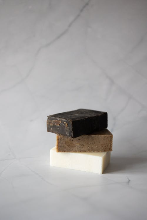 Set of natural soaps against marble background