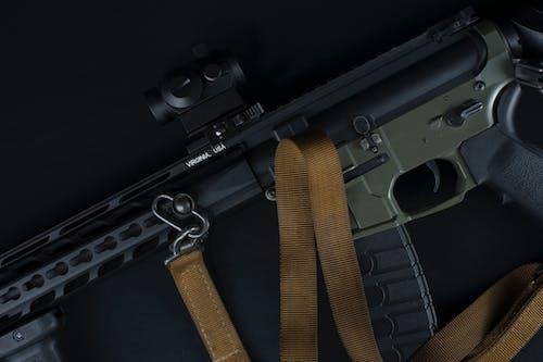 Black Semi Automatic Pistol With Brown Strap