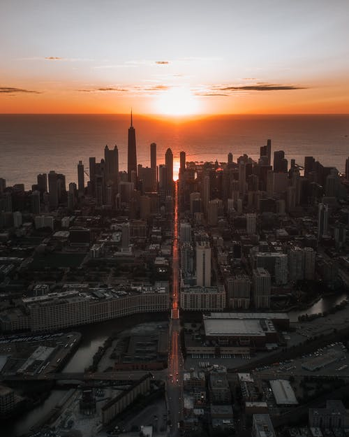 Aerial View of City Buildings during Sunset