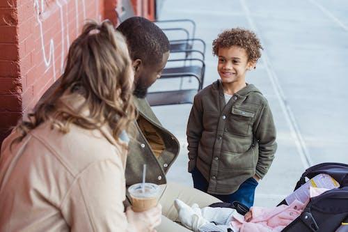 Diverse parents near smiling happy black son