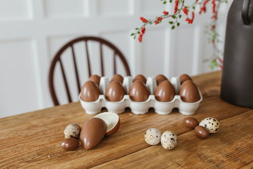Brown and White Eggs on Brown Wooden Table