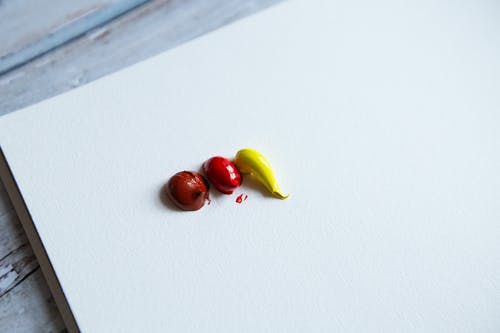 Red and Yellow Fruit on White Surface