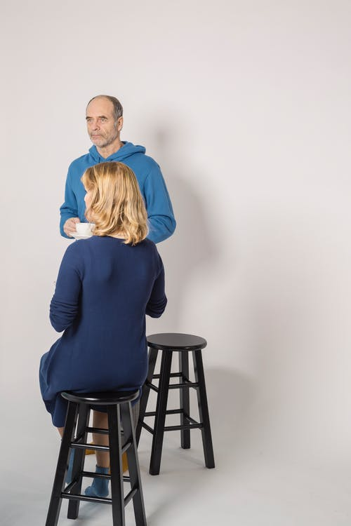 Couple Sitting in Black Bar Stools