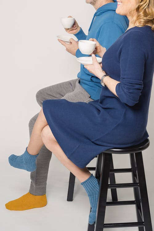 Woman in Blue Long Sleeve Dress Sitting on Black Chair