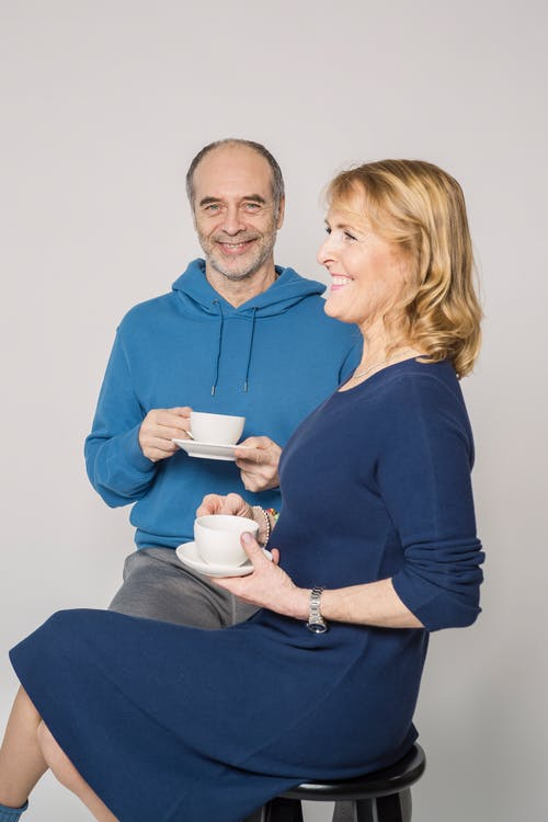 Elderly Couple Holding Cup of Coffee