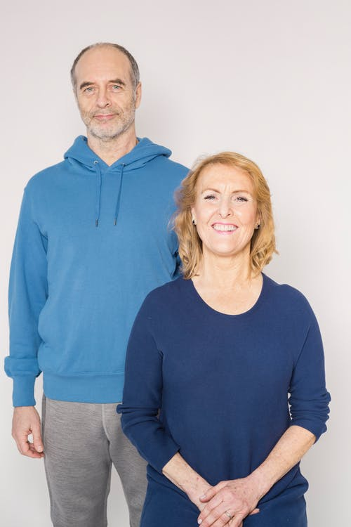Man in Blue Sweater Beside Woman in Blue Sweater