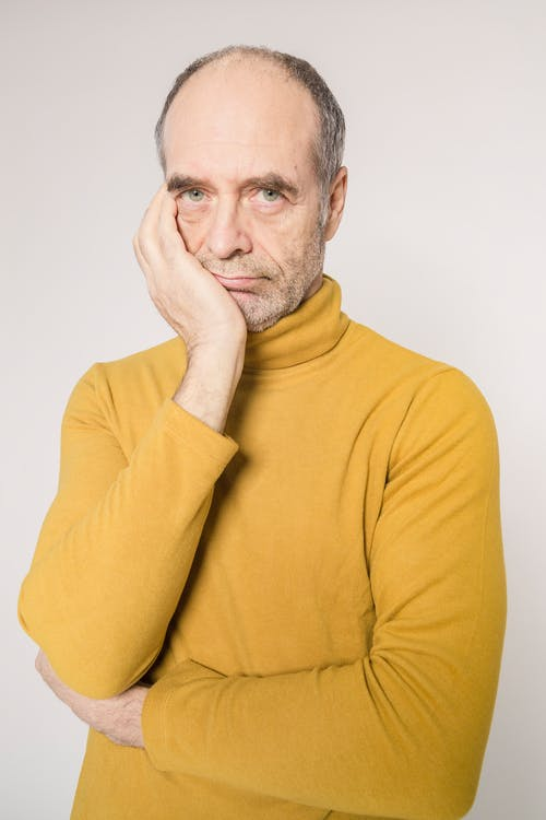Man in Yellow Turtleneck Sweater