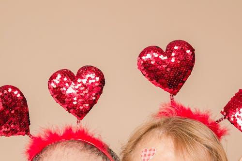 Couple Wearing Heart Headbands