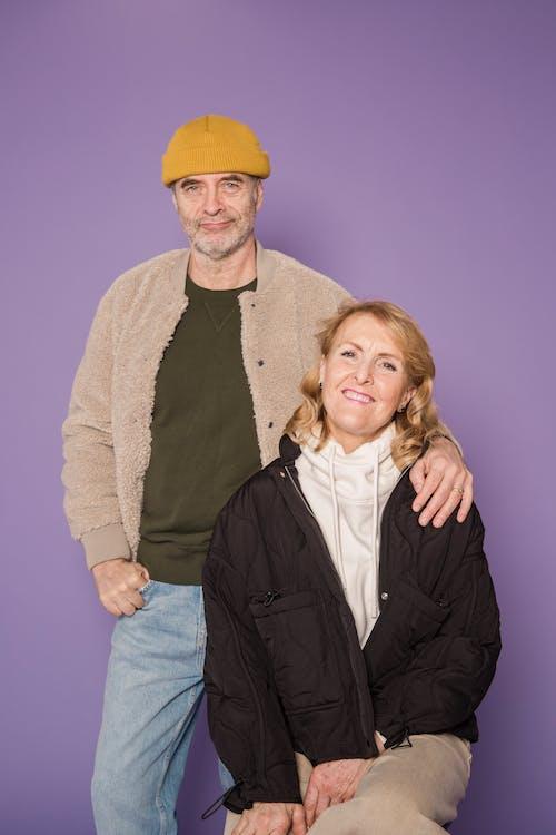 Woman in Black Zip Up Jacket Beside Man in Brown Jacket