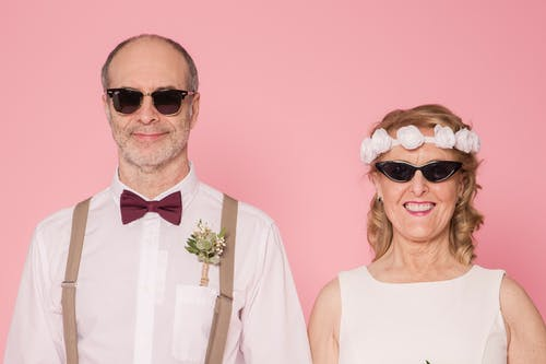 Elderly Couple Wearing Sunglasses