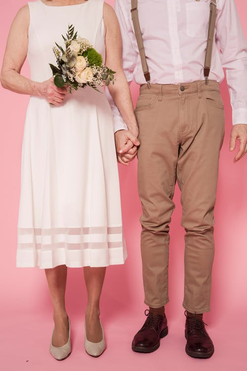 Couple Wearing Wedding Outfit