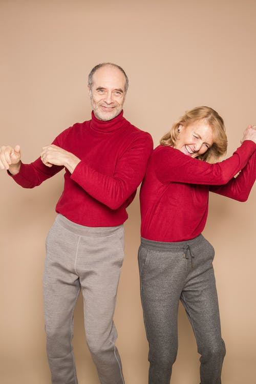 Couple in Red Sweater Dancing