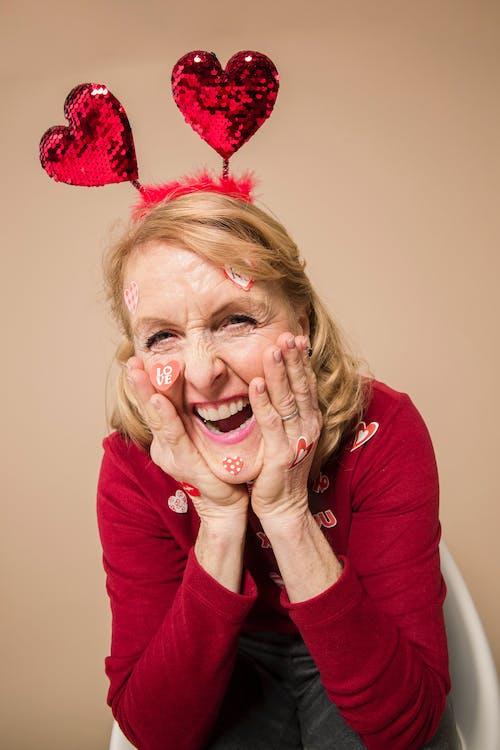 Elderly Woman Wearing Heart Headband