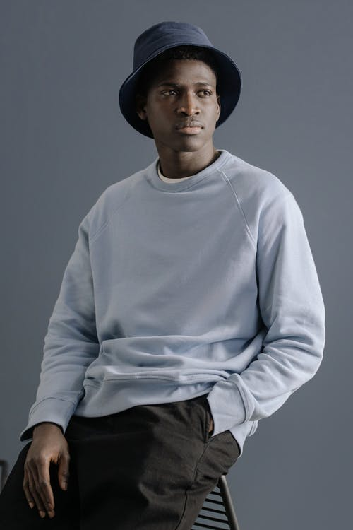 Man In A Sweater And Black Pants