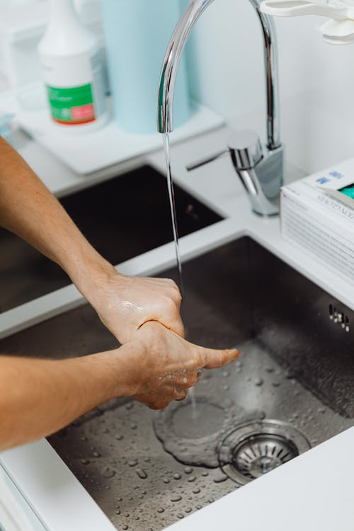 Person Cleaning his Hands Thoroughly