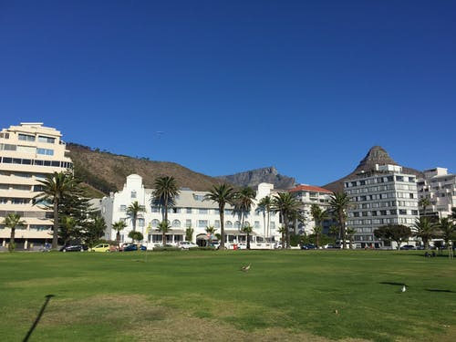 Free stock photo of appartments, coastal flats, mountain view, park