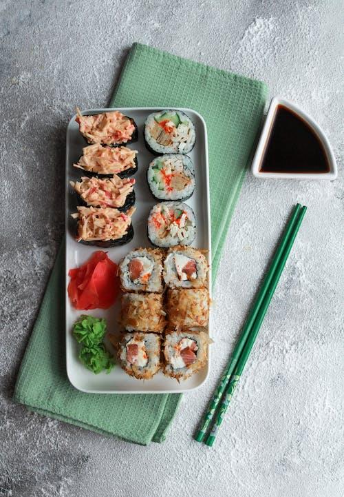 Sushi on White Ceramic Tray