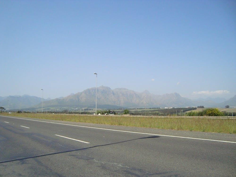 Free stock photo of country road, mountain range, mountain view