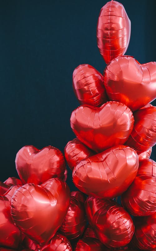 Red Heart Shaped Petals on Black Background