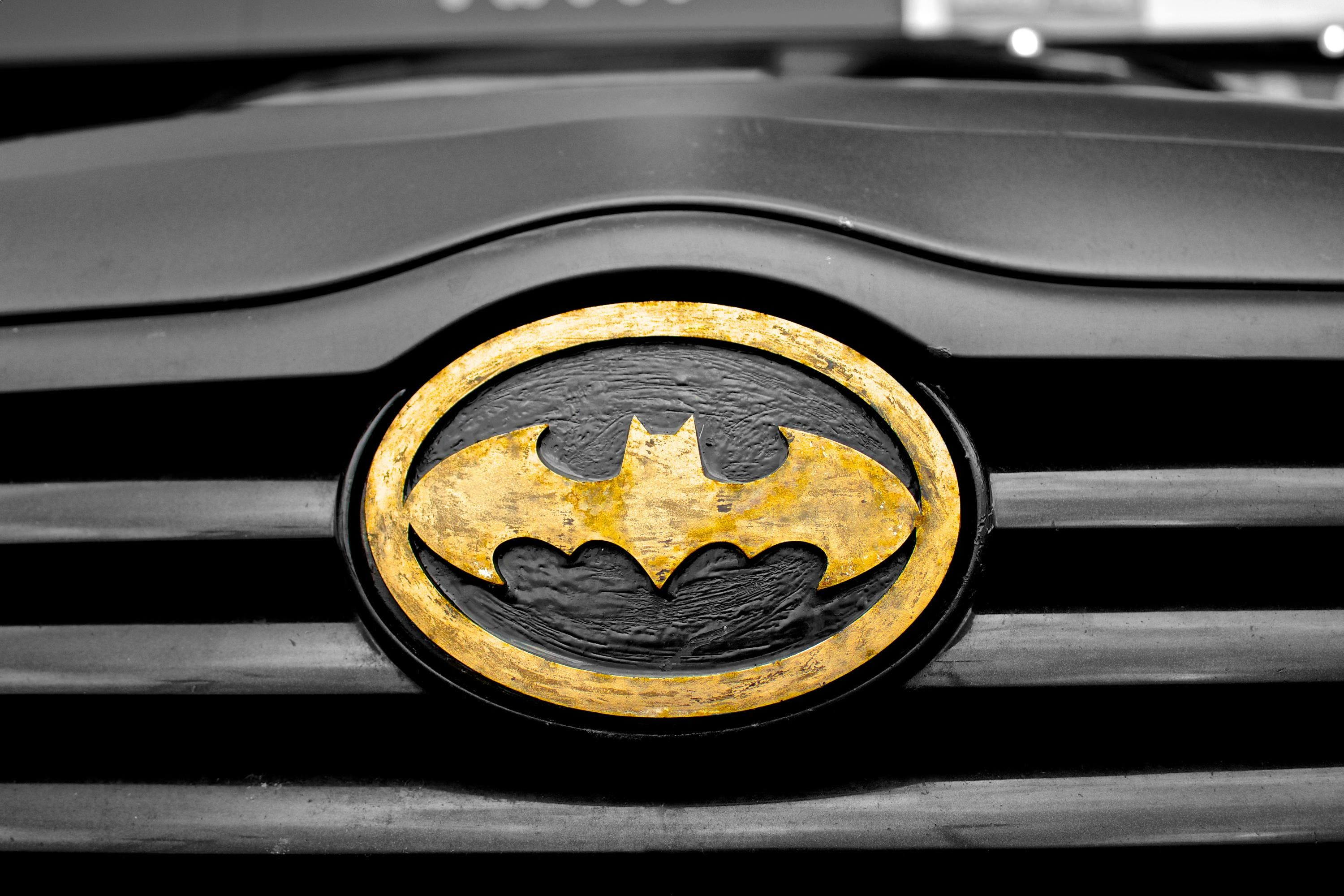 Black and Brown Batman Emblem Close-up Photography