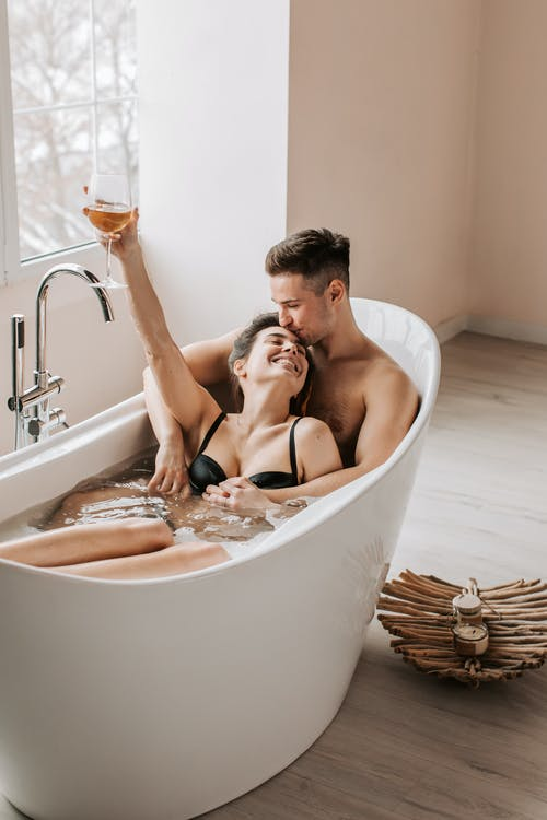 Man and Woman in Bathtub With Water