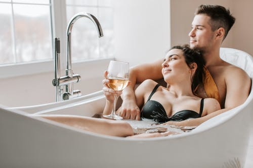 A Man and Woman Lying in the Bathtub