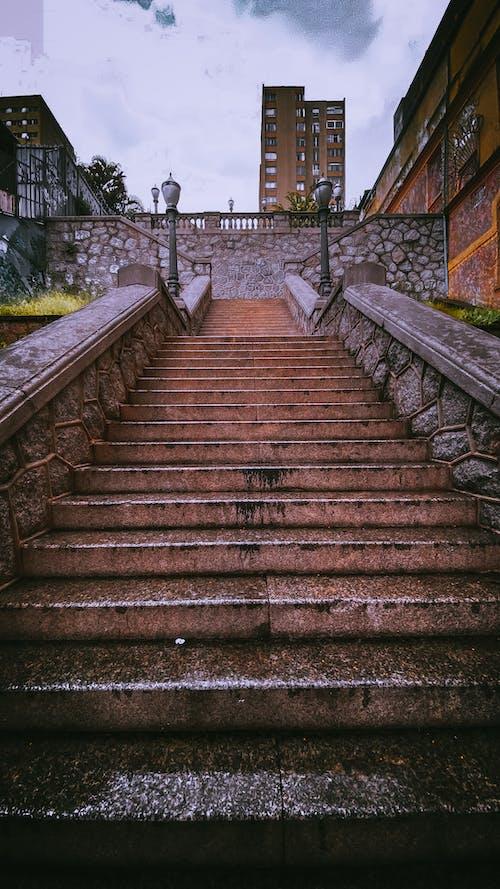 Stone shabby stairway on street
