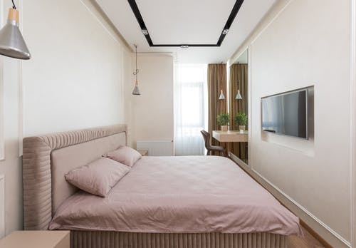 Comfortable bedroom in modern flat